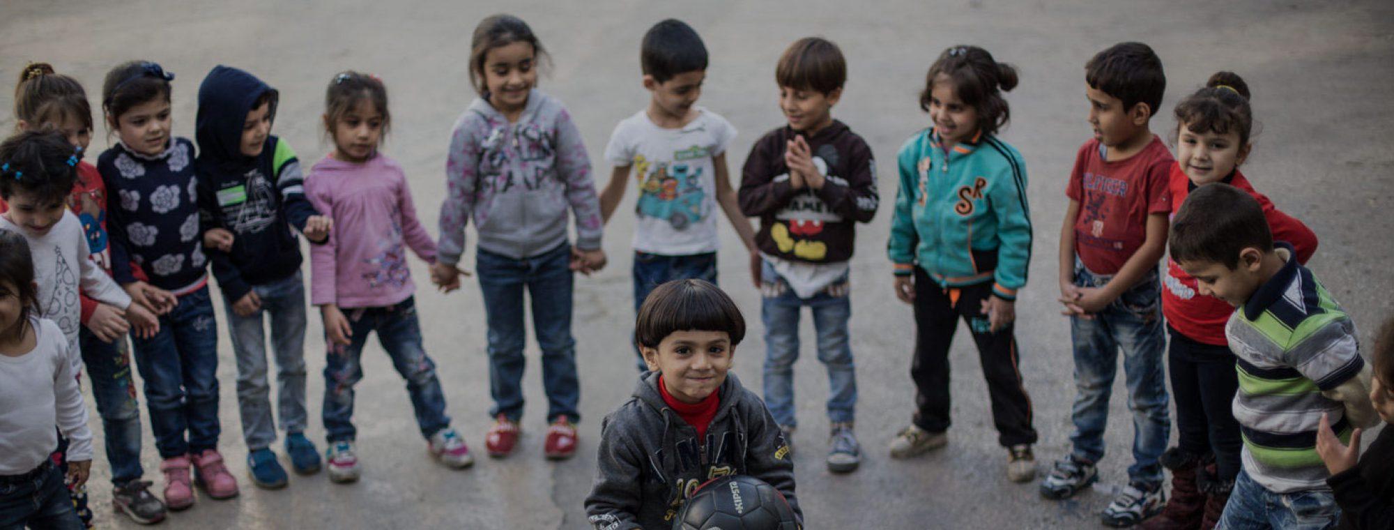Refugee children playing at a JRS school in Lebanon. (Kristóf Hölvényi/Jesuit Refugee Service)